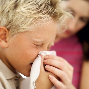 Boy Blowing His Nose into a Handkerchief --- Image by © Royalty-Free/Corbis
